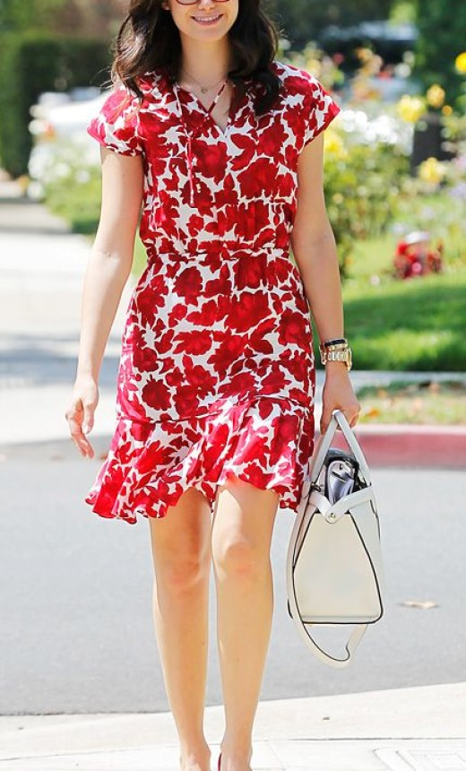 Emmy Rossum is ravishing in red glasses and matching dress in Los Angeles.