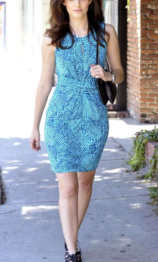 Rossum stepped out in a blue ceramic print wrap dress from the new Banana Republic x Issa collection.