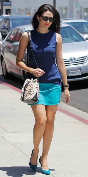 Emmy Rossum dons just the right bucket bag mixing in the perfect hint of animal print.