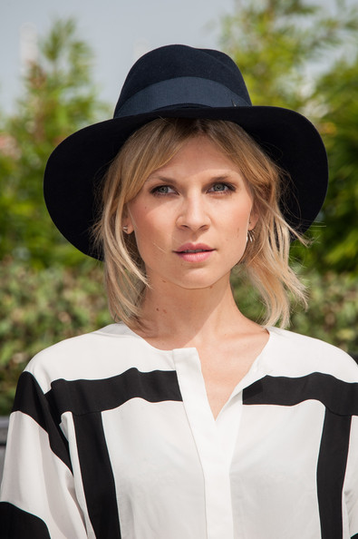 For perfect French style, try Clemence Poesy's trick and leave a few face-framing strands free under your cap.