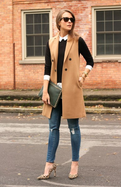 Camel vest + black fitted sweater + white button up + jeans + leopard pumps