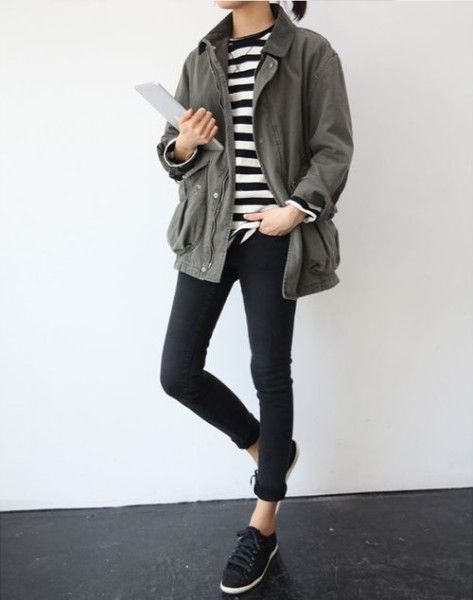 low pony tail, jacket, Black sneakers, rolled skinny jeans,