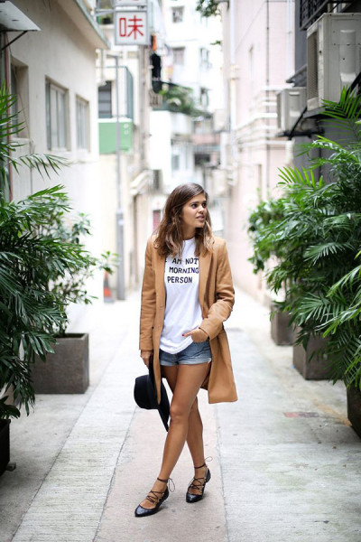 denim shorts work for early fall with a long coat and lace-up flats.