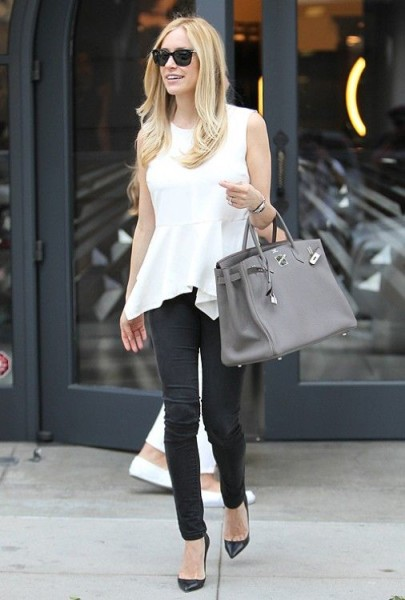 Kristin Cavallari wearing skinnies, a peplum top, Christian Louboutin pumps, and Birkin bag