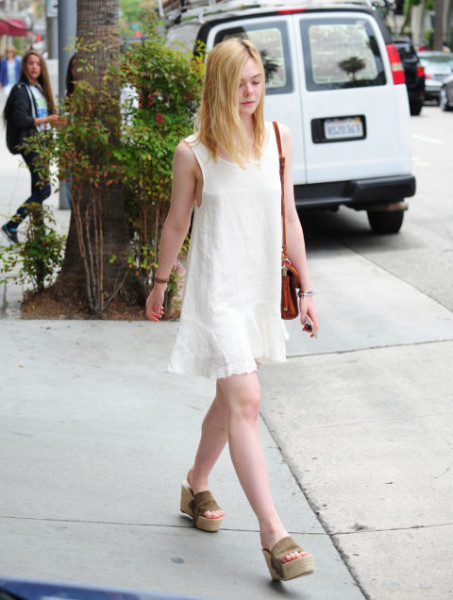 Wearing a white dress with platform sandals out in Beverly Hills.