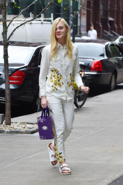 Wearing white denim-on-denim with floral detailing out in New York.