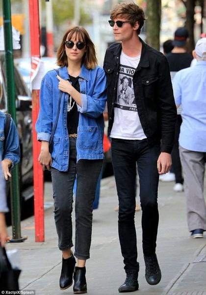 Dakota Johnson looked very close to her on-off beau Matthew Hitt in New York on Monday