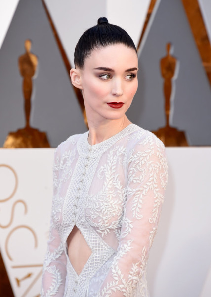 Rooney accented her ultrafair complexion with gray shadow and a defined red lip.