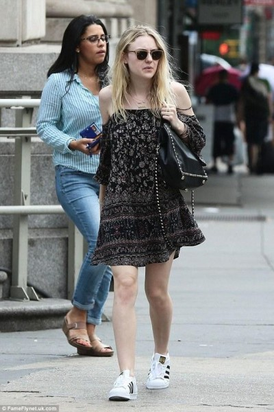 Dakota Fanning was spotted pairing an off-the-shoulder dress with a pair of adidas Originals Superstar sneaks.