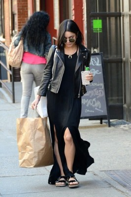 Hudgens rocked an edgy look in a leather moto jacket and maxi dress while out in NYC.