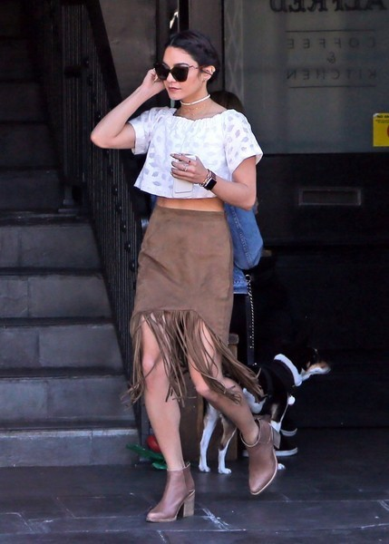 Hudgens teamed her crop top with a fringed pencil skirt and brown ankle boots while out and about.