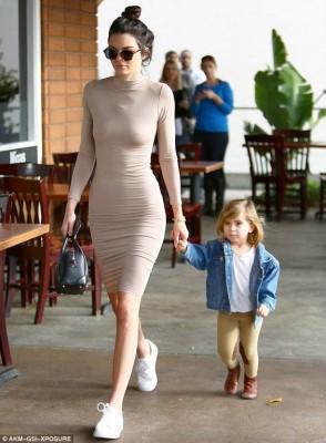 Kendall Jenner dons tight flesh-toned dress as she joins Kourtney Kardashian Daily Mail Online