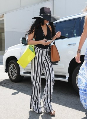 Vanessa channeled the '70s with these striped flare pants and halter top.