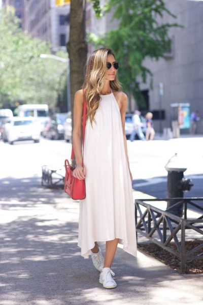White maxi dress with red Celine bag and Isabel Marant sneakers