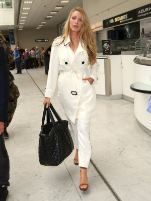 Blake Lively wore a white Burberry trench with matching white trousers, keeping things simple but chic