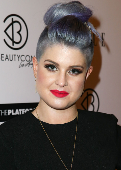 For a bit of a retro flair, Kelly Osbourne opted for a twisted top knot, complete with hair jewelry.