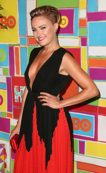 For a ladylike touch, Malin Akerman brushed her blonde strands to the side to reveal her edgy cut.