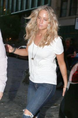 JLaw looked effortlessly gorge with blonde, beach-y waves and glow-y, makeup-free skin.