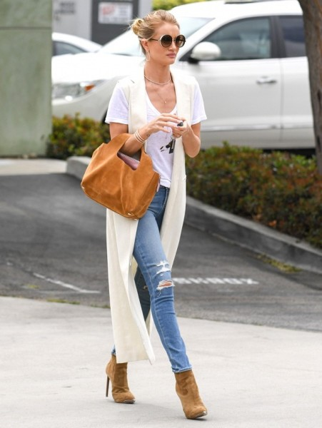 We're quite partial to the layered necklace look comprised of a choker and lariat combination, and her triple cuff and twisted hoops are just as eye-catching. Most Favorite Celebrities Spring Street Style Of The Year!