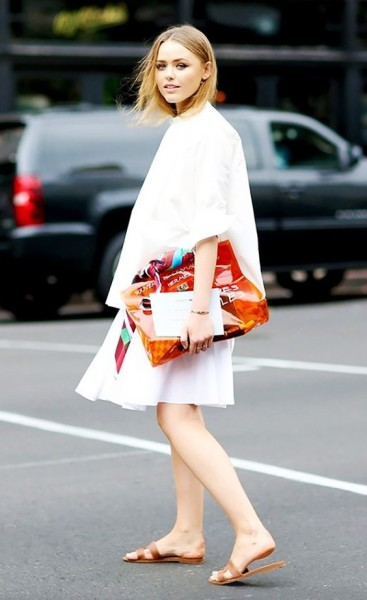 All white with Hermès sandals and a colorful clutch.