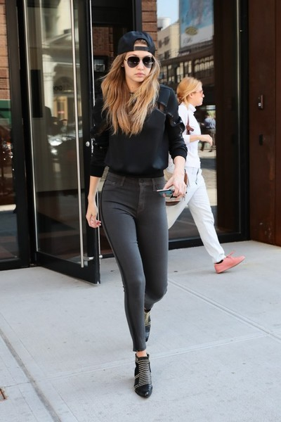 Gigi Hadid highlighted her slim pins in gray side-striped skinny jeans by Hudson.