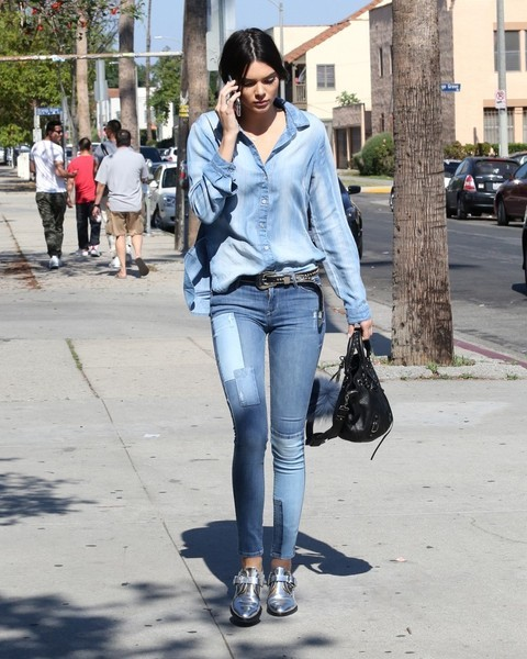 Kendall Jenner rocked denim on denim with this skinny jeans and button-down combo.
