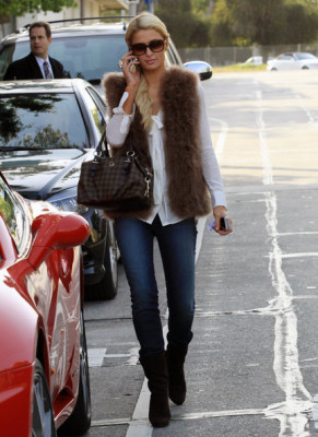 Socialite Paris Hilton took a phone call as she entered her car in Los Angeles, California on February 28, 2012