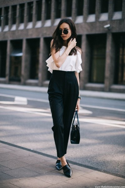 fashion blogger wearing monochrome outfit, white top with highwaisted trousers look