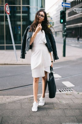 skirt with sneakers outfit, classic street style, white summer look with leather jacket