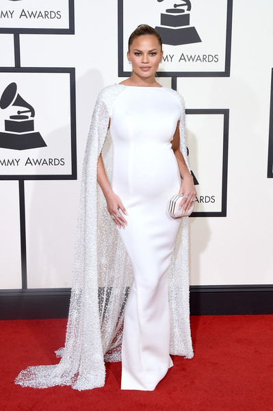 Chrissy Teigen amped up the elegance at the Grammys in a white Yousef Al-Jasmi dress with a watteau train.