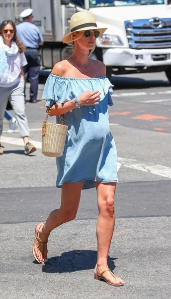 Nicky Hilton showed off her breezy maternity style with this denim off-the-shoulder dress by Zara while out in New York City.
