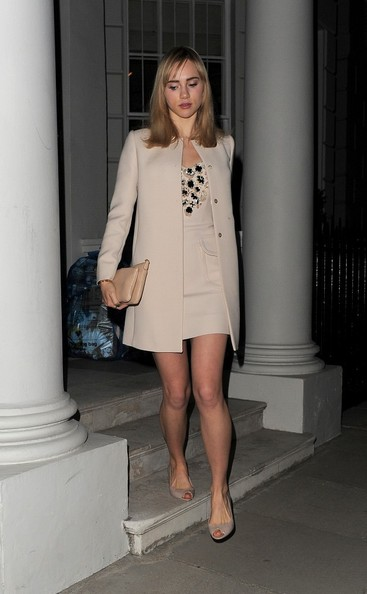 Suki Waterhouse looked very classy in a collarless nude coat layered over an embellished dress during a night out in London.