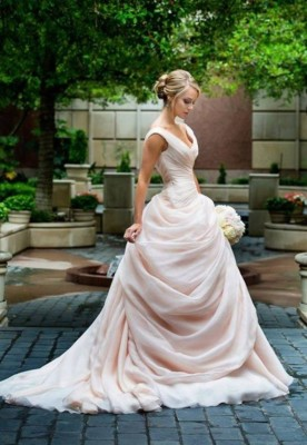 This gown's luxe skirt will make you feel like a Beauty while walking down the aisle.