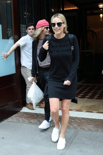 Margot Robbie kept it comfy and cute in a 'Wild Hearts Can't Be Broken' sweater dress by Zoe Karssen while out in New York City.