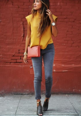 yellow top, stone washed skinny jeans, big watch