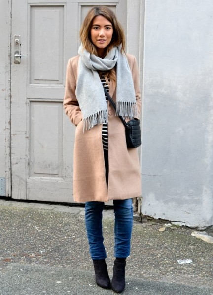 Brown camel coat, striped jersey, pale blue scarf and skinny jeans. Bet this is Paris.