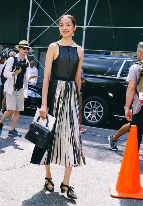 Fei Fei Sun in a Proenza Schouler dress, shoes and bag