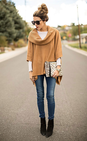 A poncho looks really cute and put-together with heeled ankle booties