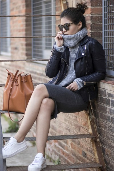Adriana Gastélum is wears this oversized turtleneck look perfectly by combining it with a gorgeous leather jacket and a grey sweater style midi skirt.