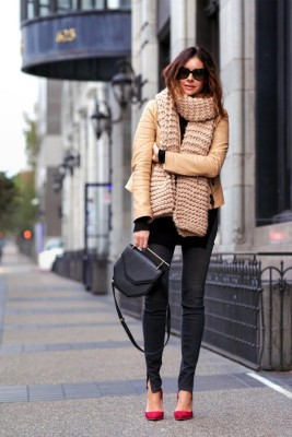 Erica Hoida accessorises this camel coat with a gorgeous chunky knit scarf; the ultimate winter piece, so if you want to follow the knitwear fashion trend of this year, copy her look.
