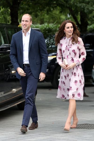 Kate Middleton kept it modest in a long-sleeve pink rose-print dress by Kate Spade while celebrating World Mental Health Day.