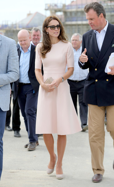Kate Middleton kept it understated in a pale-pink midi dress by Lela Rose while visiting Cornwall.
