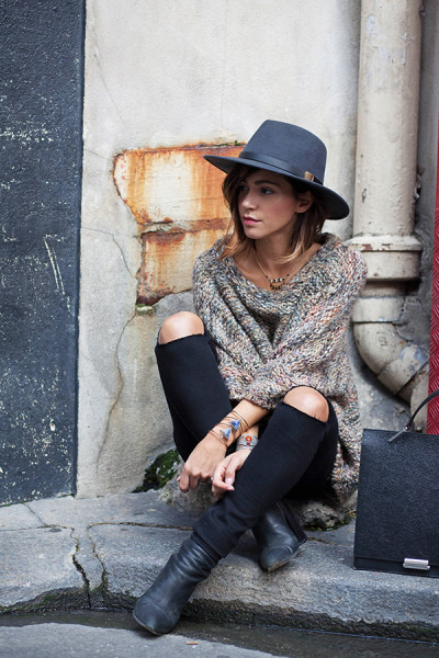 Zoé Alalouch accessorises a beige knit with alternative jewellery and a wide brimmed hat.