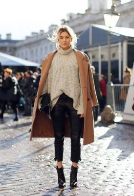 Gray oversized turtleneck sweater, off-the-shoulder styled camel coat, cropped leather pants, and black ankle boots