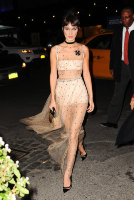 In a sheer Dior Spring 2017 dress with a black choker, ombre handbag and pointed-toe pumps while out in NYC.