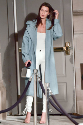 In white jeans and pale blue coat leaving the Ralph Lauren fashion show during New York Fashion Week.