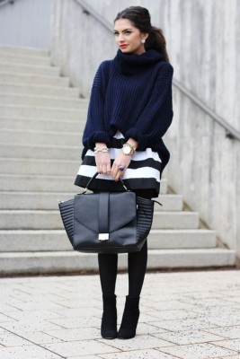 navy chunky sweater, black and white stripped skirt, black tights and booties