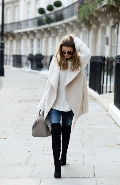 via Bloglovin black boots, cream jacket, cream jumper, blue denim jeans