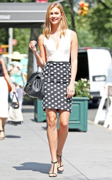 In true Karlie Kloss fashion, the model is showing us how to  do pencil skirts in a timeless yet fresh manner. Patterns bring a youthful, playfulness to the look while that cut is a straight classic.