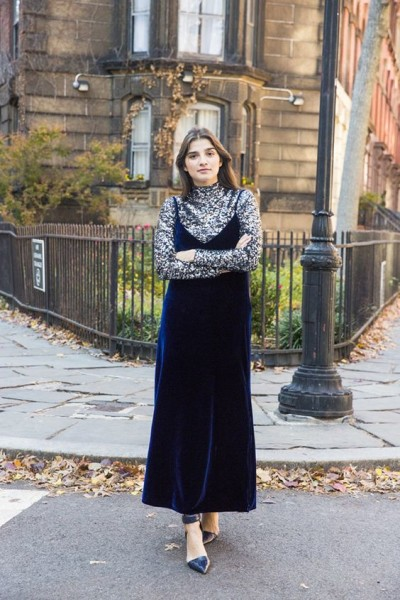 Juliana Salazar wears the same blue velvet dress